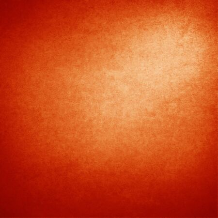 light spot: red cardboard background with beam of spot light in the corner, xmas background Stock Photo