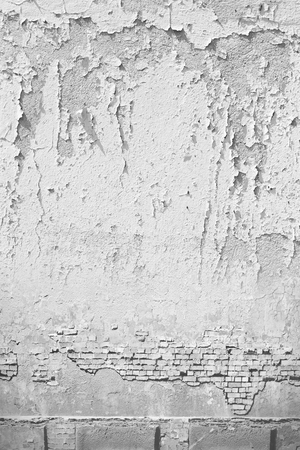 paint peeling: urban background grunge wall texture, peeling paint and brick wall in black and white Stock Photo