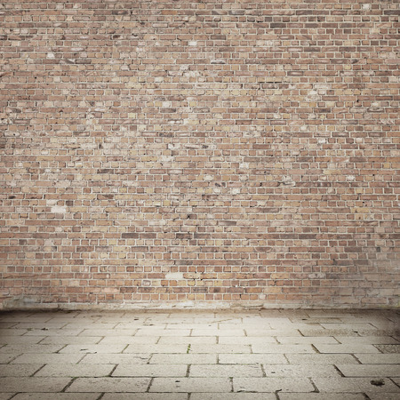 red brick: brick wall texture background and tiled pavement as exterior urban background