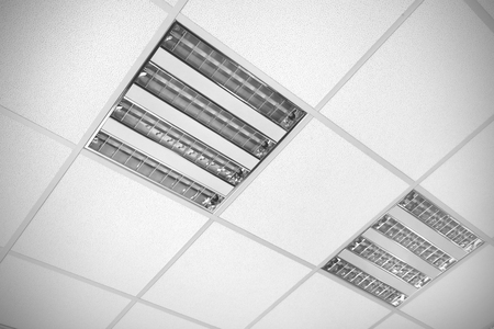 office ceiling: fluorescent lamp on the ceiling, modern office interior background