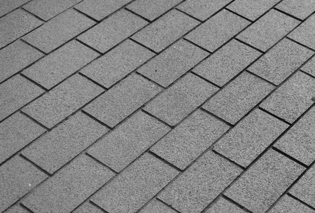 sidelong: concrete pavement tiles pattern as gray abstract urban background texture Stock Photo