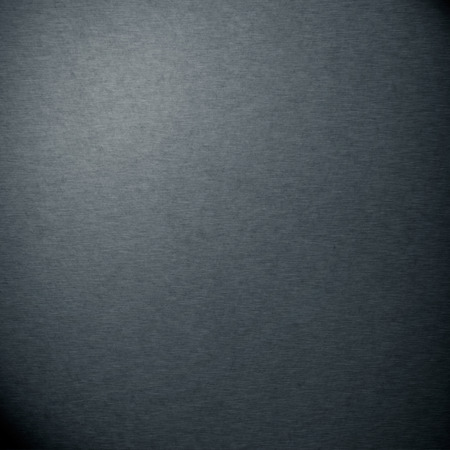 dark gray fabric texture background with vignetted corners Stockfoto
