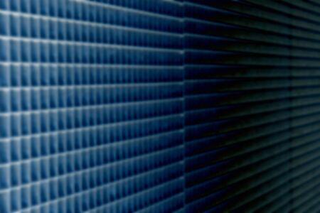 speaker grille pattern: blur background, blurred mesh texture industrial technology dark blue abstract background