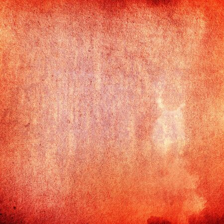 torn jeans: red grunge paint texture on old canvas background