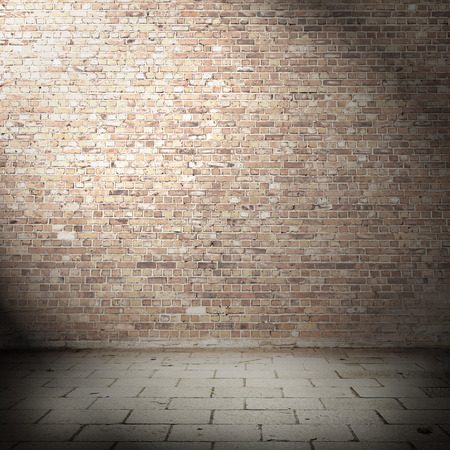 empty room interior background, red brick wall and gray tiled pavement, beam of spot light and black shadow vignette