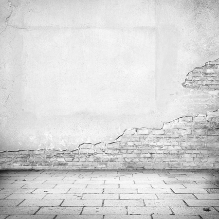 grunge background, damaged brick wall texture bright plaster wall and blocks road pavement abandoned exterior urban background for your own concept or project