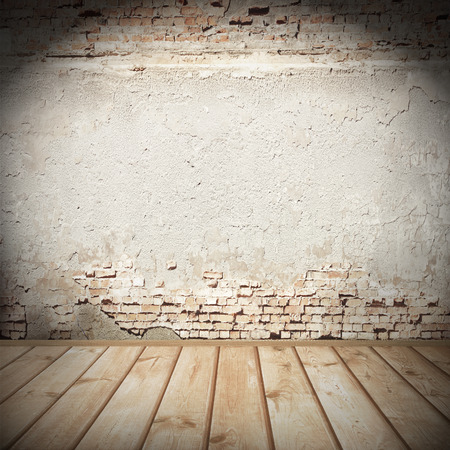 plastered wall: urban background with vignette, plastered brick wall texture and tiled wood floor abandoned interior grunge background for your concept or project Stock Photo