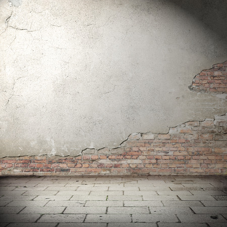 urban background with shadow vignette, plastered brick wall texture and concrete tiled floor pavement as abandoned exterior grunge background for your concept or project