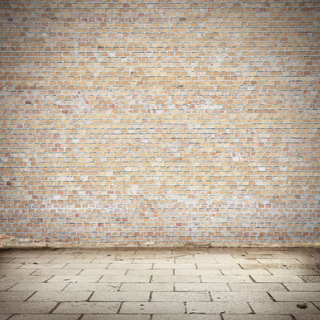 faded: brick wall texture and blocks road pavement abandoned exterior urban background for your concept or project