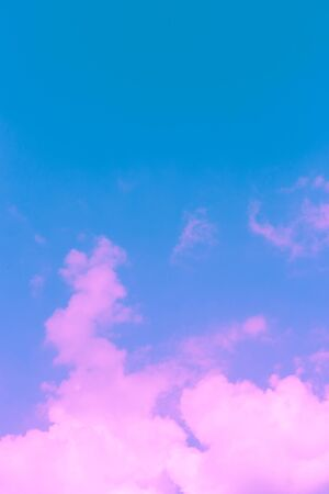 holliday: pink abstract puffy clouds on blue background