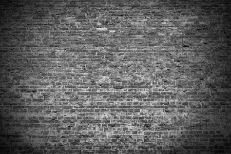 vignetted: brick wall texture grunge background with vignetted corners, may use as halloween background