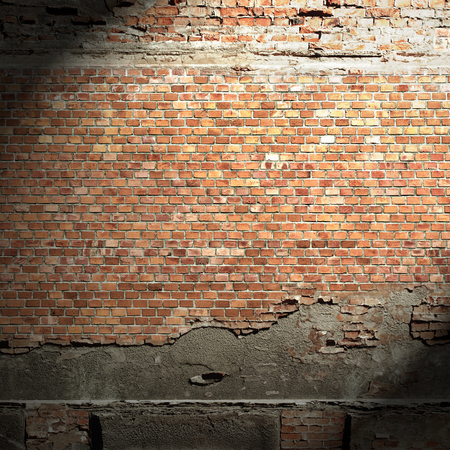 ruined house: urban background grunge brick wall texture, beam of light and shadow vignette