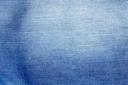 indigo: blue jeans fabric texture background, denim material texture subtle knit pattern Stock Photo