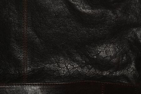 gerimpelde leder achtergrond textuur, echt leer zwarte achtergrond Stockfoto
