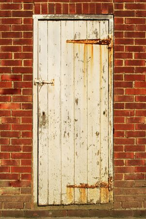 Old and weathered door showing many years of wear Stock Photo - 11545740