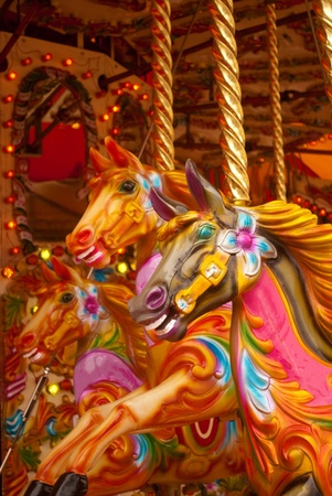 Three brightly colored carousel horses