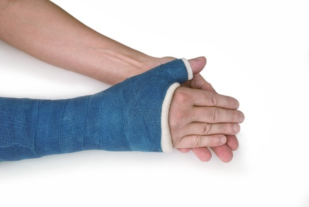 cast: Broken wrist, arm with a blue fiberglass cast on a white background