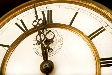 12 oclock: One minute to 12 Oclock - Old Clock Face with Roman Numerals
