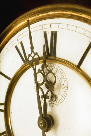 One Minute to Midnight - Old Clock Face with Roman Numerals Stock Photo - 18873491
