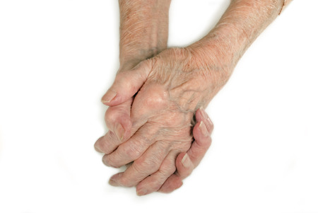 Old Ladys hands clasped - My mother at 90 years old with arthritic hands Stock Photo