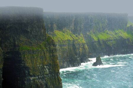moher: Cliffs of Moher Ireland rise 120 meters (394 ft) above the Atlantic Ocean at Hag Stock Photo