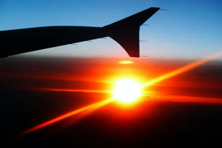 Plane silhouette in a sunset photo
