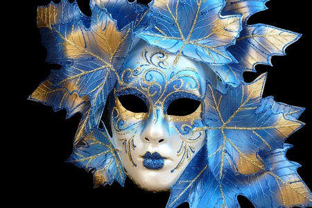 blue and gold venetian mask isolated on a black background photo