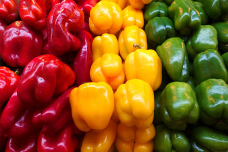 fresh yellow, red and green peppers photo