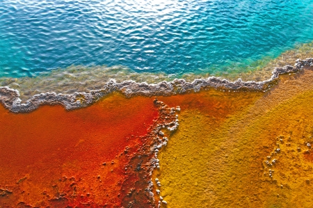Beautiful colors in a geyser pool, Yellowstone, Wyoming Stock Photo