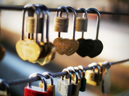 keylock: Close-up of heart shape padlock on bridge railing, Ljubljana, Slovenia, Europe Stock Photo
