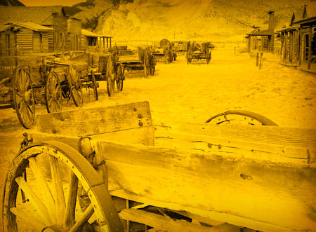 cody: Old Wooden Wagons in a Ghost Town, Cody, Wyoming, United States, vintage style Stock Photo