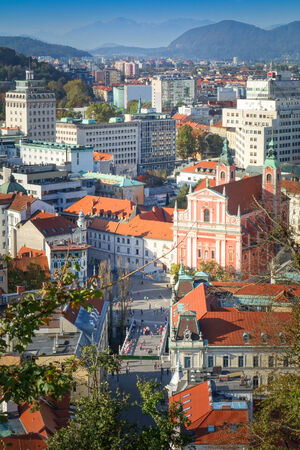 Panorama of the Slovenian capital Ljubljana, Alps mountains in the background photo