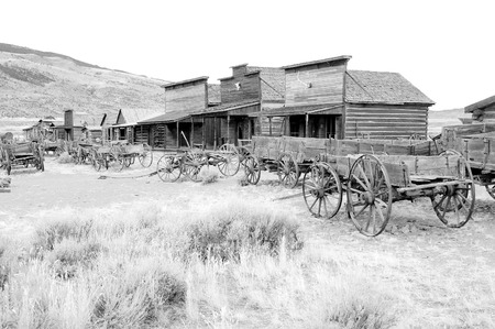 cody: Old Wooden Wagons in a Ghost Town, Cody, Wyoming, United States, black and white version