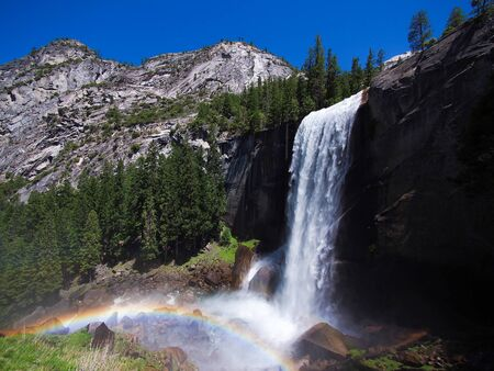 vernal: Waterfall known as Vernal Fall falling on a smooth wall of granite in Yosemite National Park, California, USA