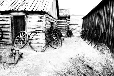 cody: Old carts in a Ghost town near Cody, Wyoming, United States; black and white version