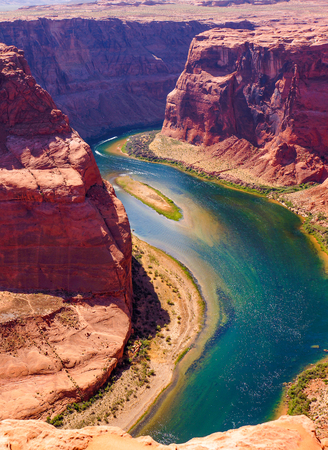 Colorado River cuts through rock at Horseshoe Bend heading for Grand Canyon Stock Photo