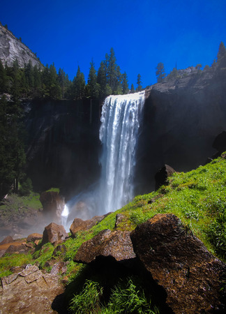 granite wall: Waterfall known as Vernal Fall falling on a smooth wall of granite in Yosemite National Park, California, USA