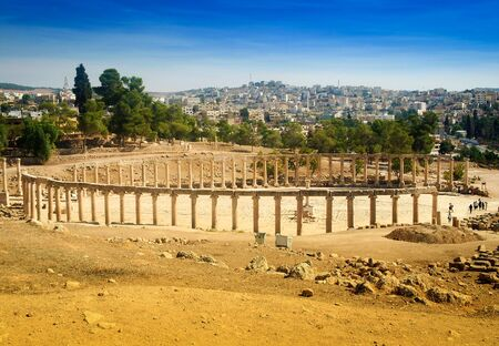 colonnaded: Forum Oval Plaza in Gerasa Jerash, Jordan. Forum is an asymmetric plaza at the beginning of the Colonnaded Street, which was built in the first century AD