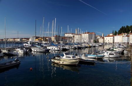 sea of houses: Piran Slovenia Motorboats and yachts moored in Marina of coastal town. With narrow streets and compact houses Piran is a town in southwestern Slovenia on the Adriatic Sea