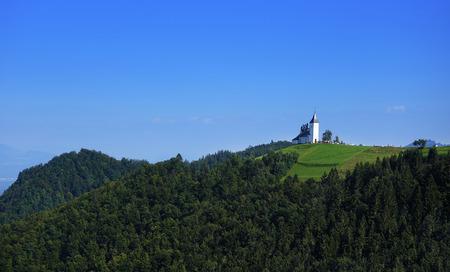 primus: Church of St. Primoz near Jamnik with Alps, Slovenia, Europe