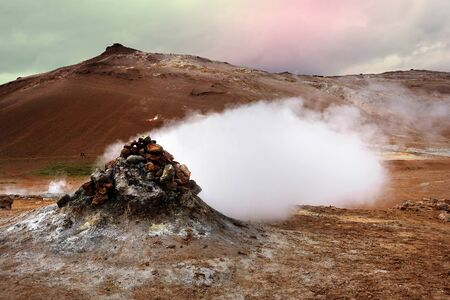 pressurized: Fumarole evacuating pressurized hot sulfurous gases from volcanic activity in the geothermal area of Hverir Iceland near Lake Myvatn