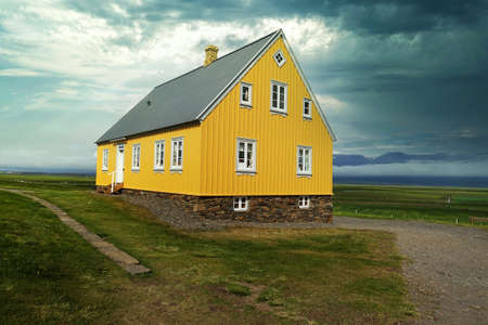 Wooden yellow house in Iceland