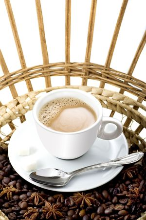 black coffee beans and white hot cup with spoon  photo