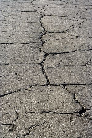 dint: Old asphalt road surface texture with fissure