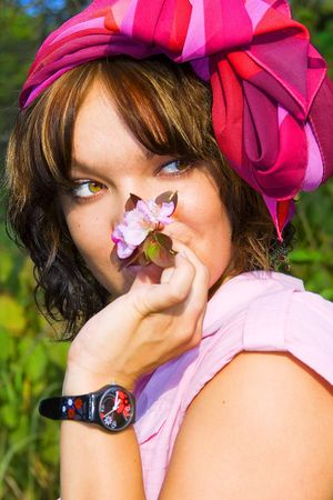 Portrait of young beatiful girl with  blooming cherry flowers. Spring flowering garden photo