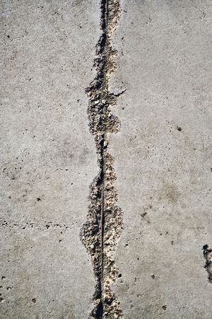 Old asphalt road surface texture with fissure photo