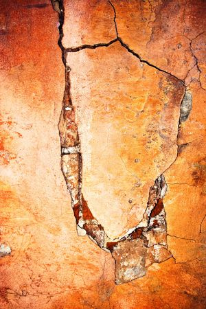 Old weathered wall with crack and peeling paint Stock Photo