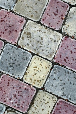 Close up asphalt road surface texture of a cobblestones with stone and fissure photo