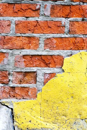 Closeup abstract old brick wall background with crack photo