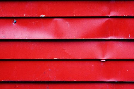 channeled: Corrugated metal sheet red color. Texture of metal fence.